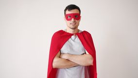 Portrait of smiling guy in superman costume standing with arms crossed alone. Looking at camera with confident face. People, character and individuality concept stock video footage