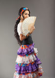 Gypsy girl with fan Royalty Free Stock Photo