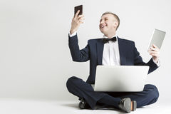 Portrait of Smiling Handsome Caucasian Man in Suit Using Digital Means Stock Photo