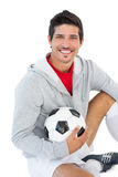 Portrait of a smiling handsome football fan Stock Photo
