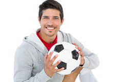 Portrait of a smiling handsome football fan Stock Images