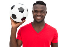 Portrait of a smiling handsome football fan Stock Photos