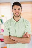 Portrait of smiling handsome masseur with arms crossed. In a studio stock image