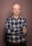 Portrait of  smiling handsome senior man looking at the camera o Stock Image