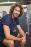 Portrait of a smiling handsome trainer in gym Stock Image