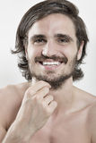 Portrait of smiling handsome young man stock photo