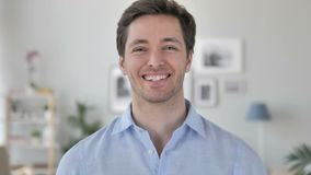 Portrait of Smiling Handsome Young Man Looking at Camera stock video