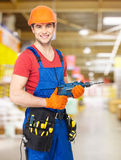 Portrait of smiling handyman with drill Royalty Free Stock Photo