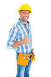 Portrait of smiling handyman gesturing thumbs up. On white background Stock Image