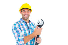Portrait of smiling handyman holding adjustable spanner Stock Photography