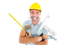 Portrait of smiling handyman holding various tools Stock Image