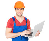 Handyman with laptop isolated on  white Stock Photos