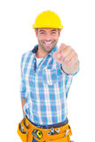 Portrait of smiling handyman pointing at you Royalty Free Stock Photography