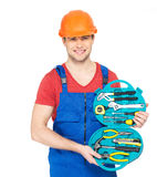 Portrait of smiling handyman with tools Royalty Free Stock Photos