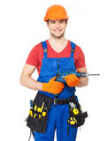 Portrait of smiling handyman with tools Stock Image