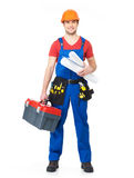 Smiling handyman with tools and paper Stock Photo