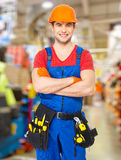 Portrait of smiling handyman with tools Stock Photo