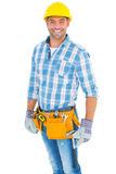Portrait of smiling handyman wearing tool belt Royalty Free Stock Photos