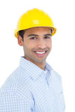 Portrait of a smiling handyman wearing a yellow hard hat Stock Photos