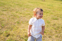 Portrait of smiling happy baby boy on natural background in summer.  Stock Images
