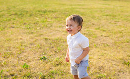 Portrait of smiling happy baby boy on natural background in summer.  Royalty Free Stock Photography