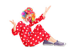 A portrait of a smiling happy clown sitting down Stock Photo