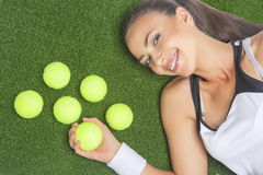 Portrait of Smiling and Happy Female Sportswoman Lying on Artifi Stock Photo