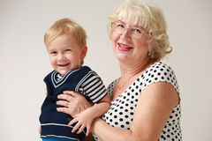 Portrait of a smiling and happy grandmother and her grandson Royalty Free Stock Photo