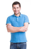 Portrait of smiling happy handsome man in blue jeans. Stock Photos
