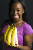 Portrait smiling happy latin woman with bananas Royalty Free Stock Photos