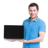 Portrait of smiling happy man holds laptop. Stock Photo