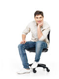 Portrait of smiling happy man sits on office chair Stock Photos