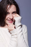 Portrait of smiling happy young brunette woman portrait in white Royalty Free Stock Photos