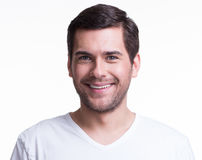 Portrait of smiling happy young man. Stock Image
