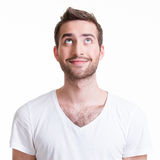 Portrait of smiling happy young man looking up. Stock Photo