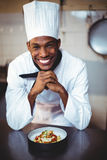 Portrait of smiling head chef presenting salad Stock Photo