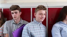 Portrait Of High School Students With Friends In Corridor stock video