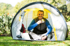 Portrait of smiling hiker having a cup of coffee in tent Stock Photo