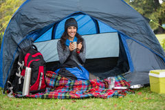Portrait of smiling hiker having a cup of coffee in tent Stock Photos