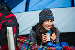 Portrait of smiling hiker having a cup of coffee in tent Royalty Free Stock Images
