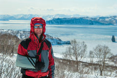 Portrait of smiling hiker, on the ocean coast in sunny winter da Royalty Free Stock Photography