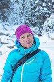 Portrait of a smiling hiker woman in a winter forest Royalty Free Stock Photos