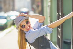 Portrait of smiling hipster girl on city street Stock Images