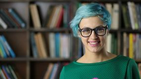 Portrait of smiling hipster girl in eyeglasses stock video