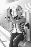 Portrait of smiling hipster girl making photo with vintage camer Stock Photo