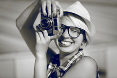 Portrait of smiling hipster girl posing with retro film camera Stock Photography