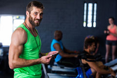Portrait of smiling hipster holding tablet in gym Stock Photography