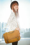 Portrait of a smiling hipster woman with a bag Stock Photo