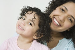 Portrait of smiling Hispanic ethnicity mother and Stock Image