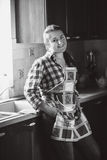 Portrait of smiling housewife in apron Stock Photography